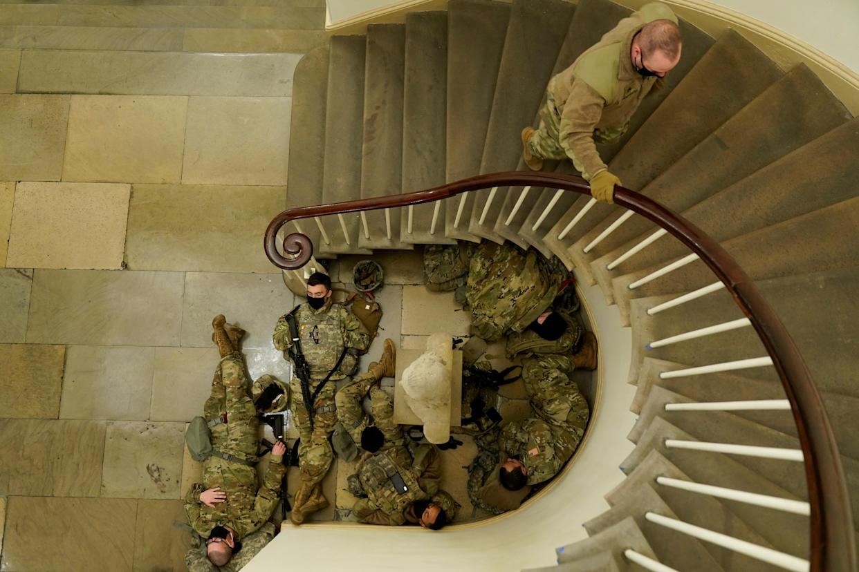 National Guard members sleep, before Democrats begin debating one article of impeachment against U.S. President Donald Trump. (Joshua Roberts/Reuters)