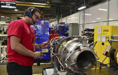 Mechanic Andrew Newingham uses a wireless headset and voice-controlled computer to quickly input details about an auxiliary power unit engine needing repairs at a Honeywell Aerospace service center in Phoenix, Arizona September 6, 2016. REUTERS/Alwyn Scott
