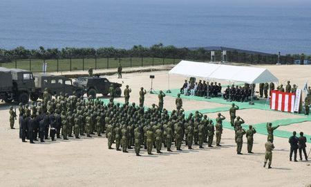 Members of Japan's Self Defence Force hold an opening ceremony of a new military base on the island of Yonaguni