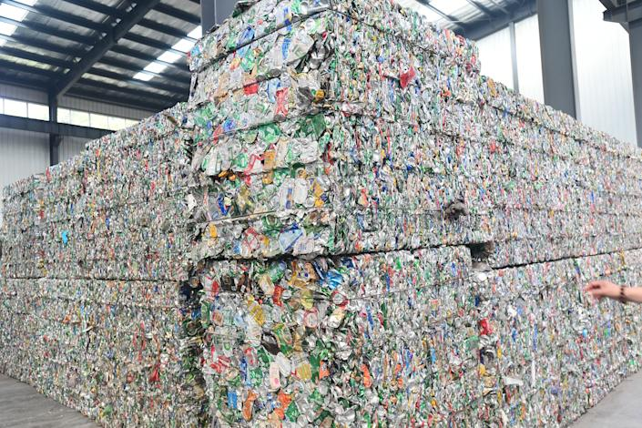 Classified garbage is packaged at a refuse processing plant Getty Images)