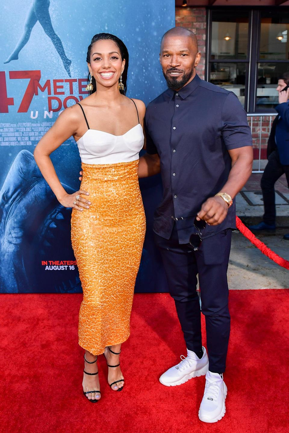 WESTWOOD, CALIFORNIA - AUGUST 13: Corinne Foxx and Jamie Foxx attend the LA Premiere of Entertainment Studios'
