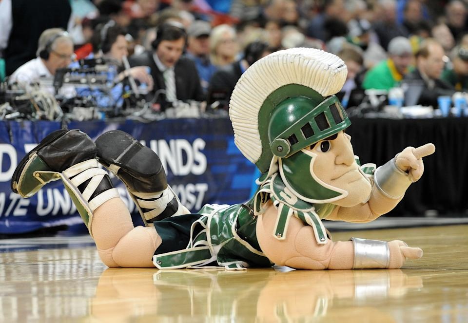 SPOKANE, WA - MARCH 20:  The Michigan State Spartans mascot cheers on his team during their game against the Delaware Fightin Blue Hens in the second round of the 2014 NCAA Men's Basketball Tournament at Spokane Veterans Memorial Arena on March 20, 2014 in Spokane, Washington.  (Photo by Steve Dykes/Getty Images)