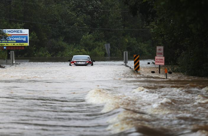 """A vehicle is seen abandoned in a flooded road after Hurricane Sally passed through the area on September 16, 2020 in Pensacola, Florida. <p class=""""copyright"""">Joe Raedle/Getty</p>"""