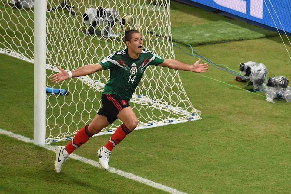 Mexico's forward Javier Hernandez reacts after scoring his team's third goal during a World Cup match between Croatia and Mexico in Recife on June 23, 2014 (AFP Photo/Javier Soriano)
