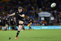 New Zealand's Jordie Barrett kicks a conversion during their Rugby Championship match against Argentina on Sunday, Sept. 12, 2021, on the Gold Coast, Australia. (AP Photo/Tertius Pickard)