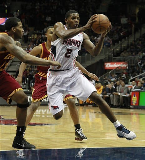 Atlanta Hawks shooting guard Joe Johnson (2) drives past Cleveland Cavaliers point guard Ramon Sessions (3) and Cavaliers small forward Alonzo Gee, left, in the first half of an NBA basketball game Saturday, Jan. 21, 2012, in Atlanta. (AP Photo/John Bazemore)