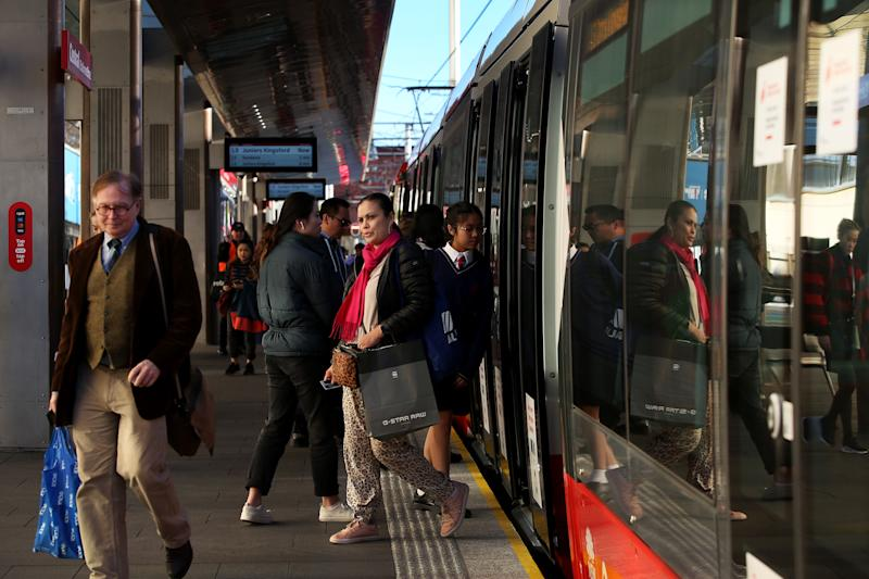 SYDNEY, AUSTRALIA - JULY 01: Commuters make their way onto the light rail platform at Central Station on July 01, 2020 in Sydney, Australia. Public transport capacity has increased as COVID-19 restrictions eased further across NSW today. Restrictions on entertainment venues, weddings, community sport and other gatherings have eased in NSW from today but strict physical distancing measures remain in place. (Photo by Lisa Maree Williams/Getty Images)