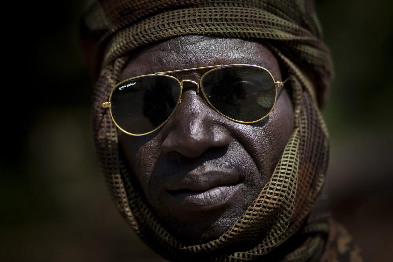 A Chadian soldier fighting in support of Central African Republic president Francois Bozize, sits on a truck in a convoy of other Chadian soldiers near Damara, about 70km (44 miles) north of the capital Bangui, Central African Republic Wednesday, Jan. 2, 2013. After troops under Bozize seized the capital in 2003 amid volleys of machine-gun and mortar fire, he dissolved the constitution and parliament, and now a decade later it is Bozize himself who could be ousted from power with rebels having seized more than half the country and made their way to the doorstep of the capital in less than a month. (AP Photo/Ben Curtis)