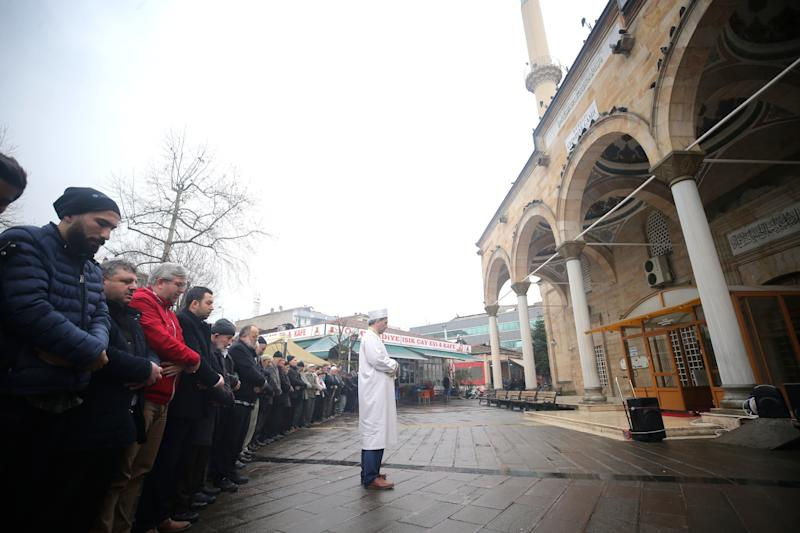People attend a funeral ceremony in absentia in Duzce, Turkey, for the victims of the shootings.