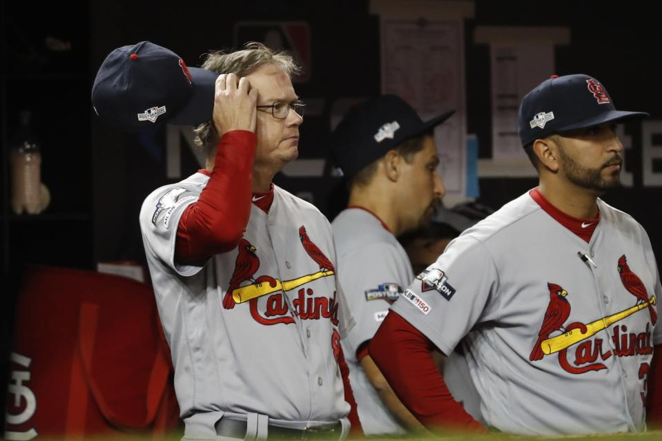 St. Louis Cardinals manager Mike Shildt scratches his head during the eighth inning of Game 3 of the baseball National League Championship Series against the Washington Nationals Monday, Oct. 14, 2019, in Washington. (AP Photo/Jeff Roberson)