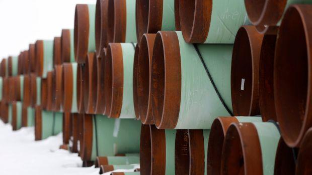 Dozens of bright green and leather brown pipes are stacked and piled in a depot for Transcanada Corps planned Keystone XL oil pipeline in North Dakota.