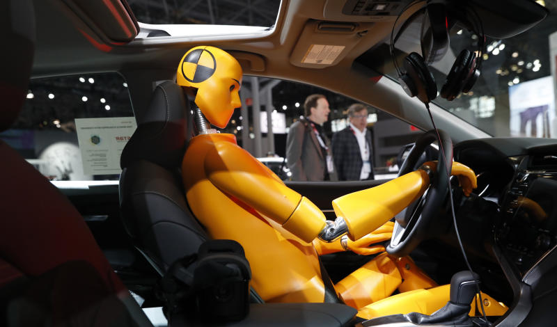 A crash test model is displayed inside a 2018 Toyota Camry on the floor of the New York Auto Show in the Manhattan borough of New York City, New York, U.S., March 29, 2018. REUTERS/Shannon Stapleton
