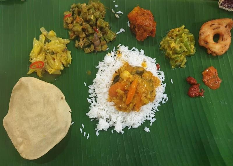 Some of the food that Melani will be cooking for the new year which include vadai, fried cabbage and sambar served on banana leaf. — Picture courtesy of Melani Hansika