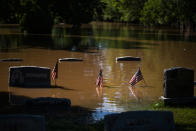 Headstones at a cemetery that flooded are seen in Somerville, N.J. Thursday, Sept. 2, 2021. A stunned U.S. East Coast faced a rising death toll, surging rivers, tornado damage and continuing calls for rescue Thursday after the remnants of Hurricane Ida walloped the region with record-breaking rain, drowning more than two dozen people in their homes and cars. (AP Photo/Eduardo Munoz Alvarez)