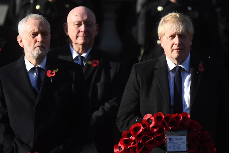 Jeremy Corbyn and Boris Johnson took a break from election campaigning to remember those who lost their lives in conflict (Picture: PA)