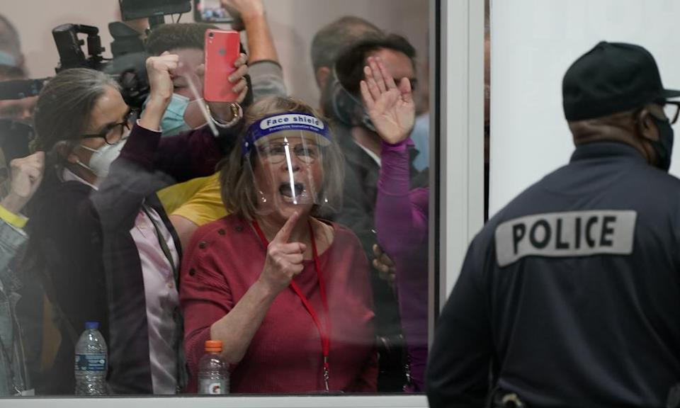 Election challengers yelling at police at the central counting board in Detroit, Michigan, in November.