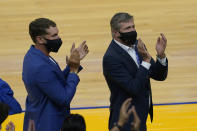 Outgoing Golden State Warriors president and COO Rick Welts, right, acknowledges fans next to his husband, Todd Gage, during the first half of an NBA basketball game against the Memphis Grizzlies in San Francisco, Sunday, May 16, 2021. (AP Photo/Jeff Chiu)