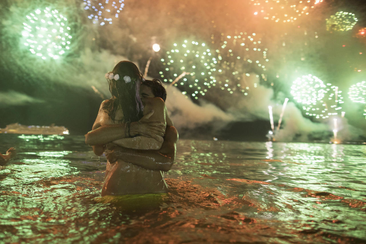 <p>A couple hug each other as they watch fireworks exploding over Copacabana beach during New Year's celebrations in Rio de Janeiro, Brazil, Monday, Jan. 1, 2018. (Photo: Leo Correa/AP) </p>