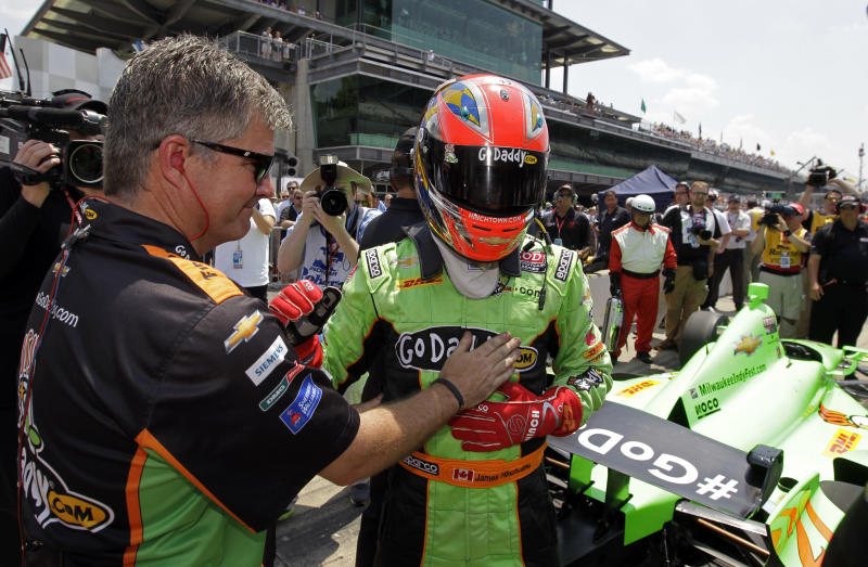 IndyCar driver James Hinchcliffe, of Canada, is congratulated by a crewman after he qualified on the first day of qualifications for the Indianapolis 500 auto race at the Indianapolis Motor Speedway in Indianapolis, Saturday, May 19, 2012. (AP Photo/Darron Cummings)