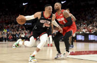 Houston Rockets guard Russell Westbrook, left, drives to the basket on Portland Trail Blazers guard Damian Lillard during the first half of an NBA basketball game in Portland, Ore., Wednesday, Jan. 29, 2020. (AP Photo/Steve Dykes)