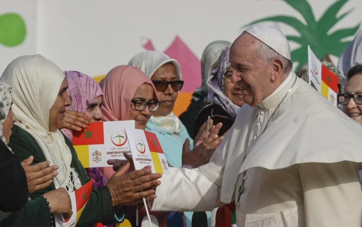 Pope Francis greets women upon his arrival to the Rural Center for Social Services at Temara, south of Rabat, Morocco, Sunday, March 31, 2019. Pope Francis is in Morocco for a two-day trip aimed at highlighting the North African nation's Christian-Muslim ties, while also showing solidarity with migrants at Europe's door and tending to a tiny Catholic flock. (AP Photo/Gregorio Borgia)
