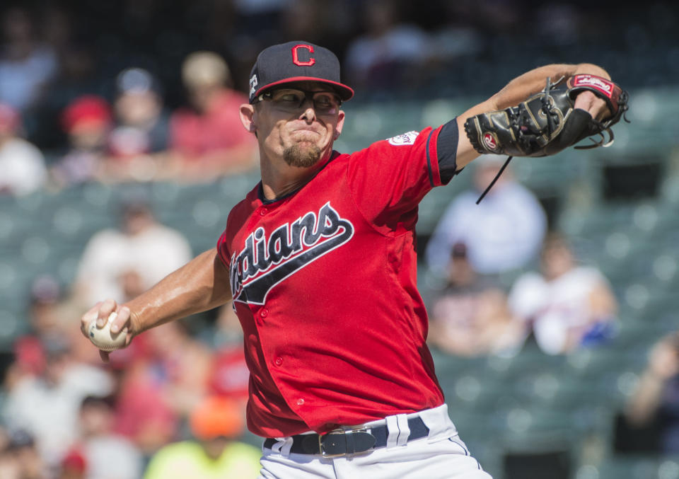 Cleveland Indians starting pitcher Tyler Clippard delivers to Texas Rangers' Shin-Soo Choo during the first inning of the second game of a baseball doubleheader in Cleveland, Wednesday, Aug. 7, 2019. (AP Photo/Phil Long)