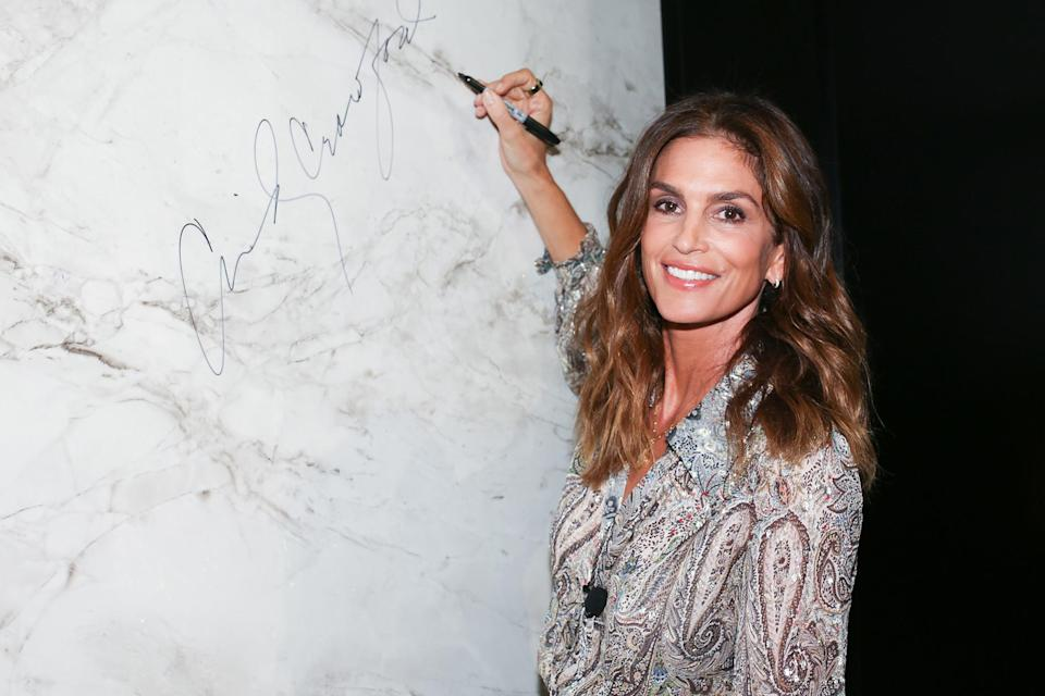 <p>Silestone brand ambassador Cindy Crawford makes her mark on Sept. 9 at the Cosentino Chicago City Center Grand Opening party.</p>