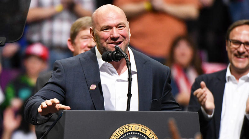Ultimate Fighting Championship President Dana White smiles and speaks on stage.
