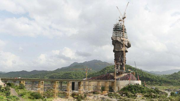 PHOTO: Indian workers carry on construction works at the 'Statue Of Unity,' a monument dedicated to Indian independence leader Vallabhbhai Patel, at Kevadiya Colony in the vicinity of Narmada Dam, Aug. 25, 2018, from Ahmedabad in Gujarat state. (Sam Panthaky/AFP/Getty Images)