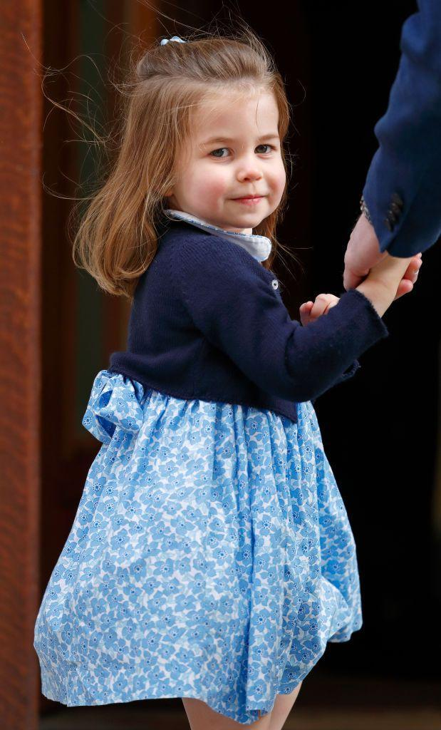 <p>Princess Charlotte has perfected the over-the-shoulder pose, as she looks back at the cameras before entering St. Mary's Hospital to visit her newborn baby brother, Prince Louis. </p>