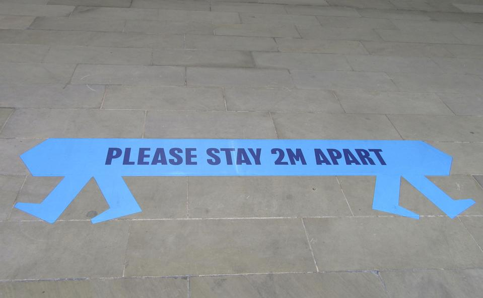 A sign reading 'Please stay 2m Apart' on pavements in London. Social Distancing, Hand Sanitiser stations and NHS signage around London as Lockdown restrictions are loosened by allowing Pubs, Restaurants and all retail to re-open. (Photo by Keith Mayhew / SOPA Images/Sipa USA)