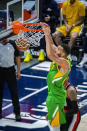 Utah Jazz center Rudy Gobert dunks during the first half of the team's NBA basketball game against the Portland Trail Blazers on Thursday, April 8, 2021, in Salt Lake City. (AP Photo/Isaac Hale)