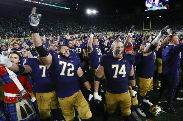 Notre Dame offensive linemen Robert Hainsey (72) and Liam Eichenberg (74) celebrate after defeating Southern California in an NCAA college football game in South Bend, Ind., Saturday, Oct. 12, 2019. (AP Photo/Paul Sancya)