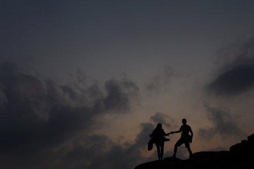 "File photo shows a couple walking on rocks near a beach in Hong Hong. ""Hong Kong is too crowded and lacks the privacy people need to have sex,"" said sex expert Emil Ng"