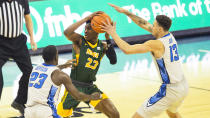 North Dakota State's Maleeck Harden-Hayes, center, looks to pass under coverage from Creighton's Damien Jefferson, left, and Christian Bishop during the first half of an NCAA college basketball game in Omaha, Neb., Sunday, Nov. 29, 2020. (AP Photo/Kayla Wolf)