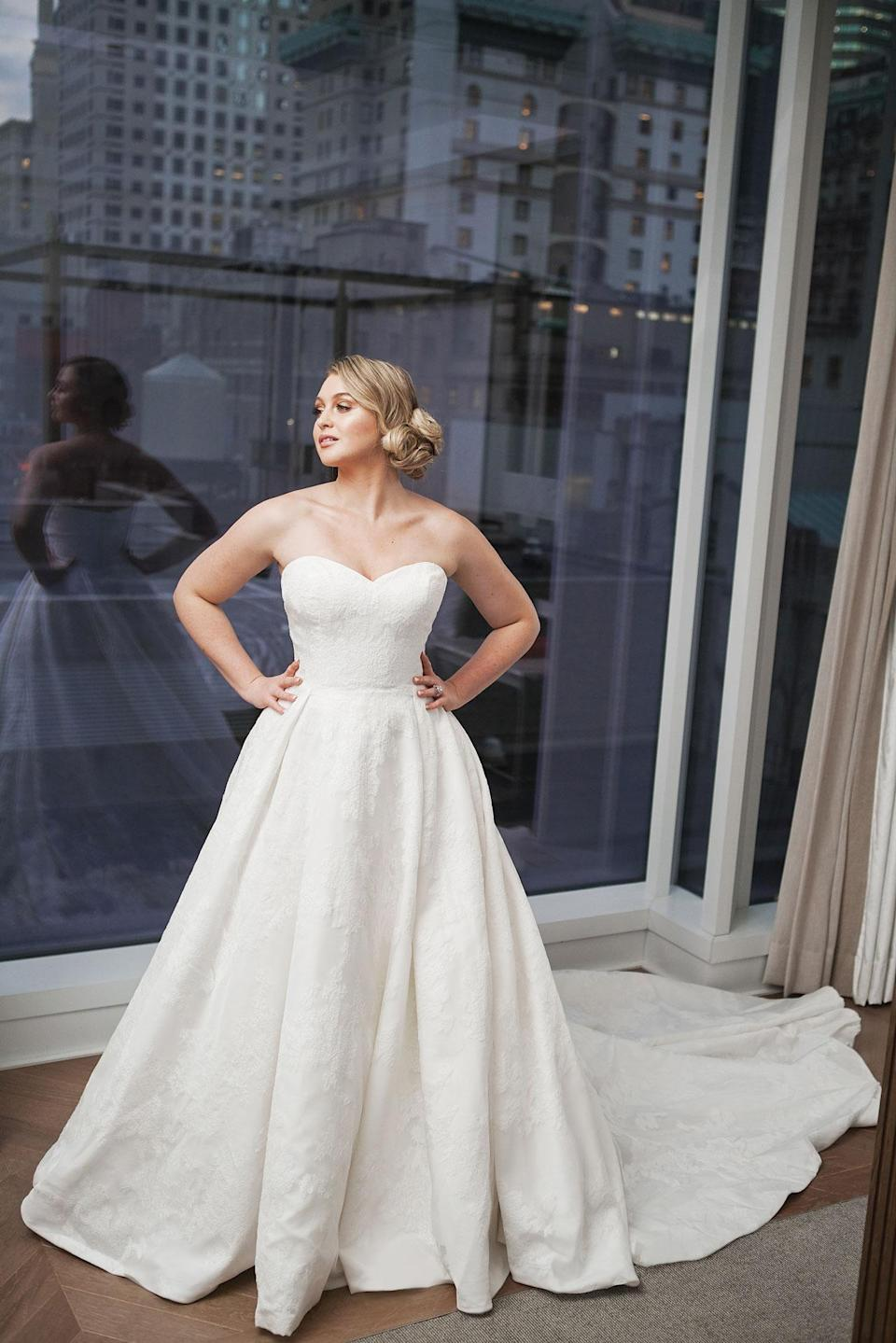 <p>Lawrence wears a classic strapless lace wedding dress by Justin Alexander. (Photo: courtesy of Justin Alexander) </p>