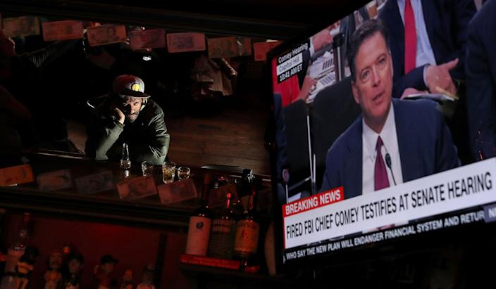 <p>JUN. 8, 2017 – A bar patron at Ace's Bar in San Francisco, watches a television broadcast as former FBI Director James Comey testifies before the Senate Intelligence Committee. People across the country are flocking to bars and restaurants to watch former FBI director as he testifies before the Senate Intelligence Committee about his conversations with U.S. President Donald Trump. (Photo: Justin Sullivan/Getty Images) </p>