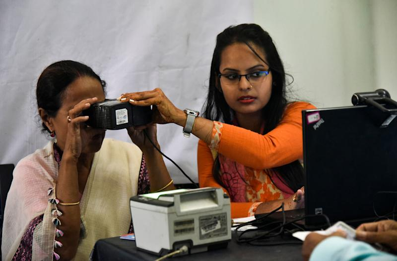 A woman scanning her eyes at an Aadhar registration office in Guwahati on 8 October 2018.