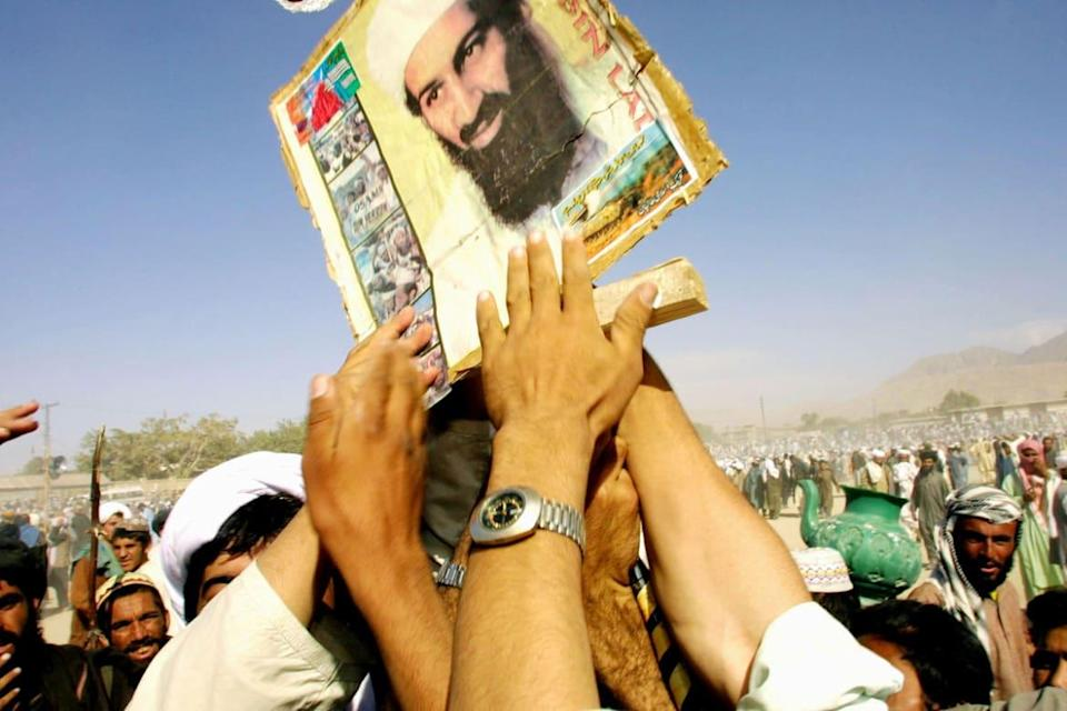 """<div class=""""inline-image__caption""""><p>Pro-Taliban supporters hold up a poster of Osama bin Laden during a rally October 1, 2001 in the town of Quetta, Pakistan. </p></div> <div class=""""inline-image__credit"""">Paula Bronstein/Getty</div>"""