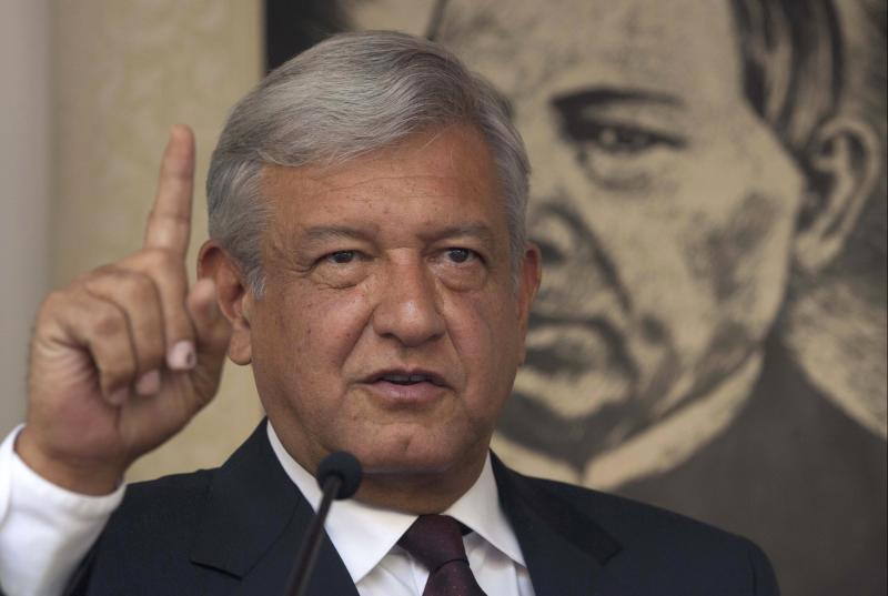 Andres Manuel Lopez Obrador, presidential candidate for the Democratic Revolution Party (PRD), speaks during a news conference in Mexico City, Friday, July 06, 2012. The official count in Mexico's presidential election concluded Friday with results showing that presidential candidate Enrique Pena Nieto got about 3.3 million more votes than his closest rival, Lopez Obrador, giving him a 6.6 percent lead in the former ruling party's bid to regain power. Lopez Obrador said Friday he will challenge the results.(AP Photo/Alexandre Meneghini)