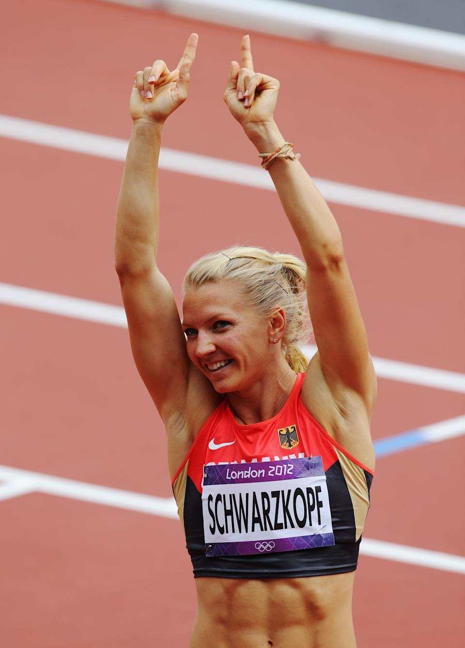 LONDON, ENGLAND - AUGUST 03: Lilli Schwarzkopf of Germany celebrates after competing in the Women's Heptathlon 100m Hurdles Heat 1 on Day 7 of the London 2012 Olympic Games at Olympic Stadium on August 3, 2012 in London, England. (Photo by Streeter Lecka/Getty Images)