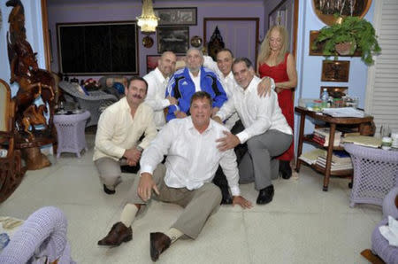 "Cuba's former President Fidel Castro (C, in blue jacket) and his wife Dalia Soto Del Valle (R, in red dress) pose for a photograph with the so-called ""Cuban Five"" Ramon Labanino (C, front), Fernando Gonzalez (L), Gerardo Hernandez (2nd L), Antonio Guerrero (3rd R) and Rene Gonzalez (2nd R) in this picture provided by Cubadebate. Castro, 88, finally met with all five of the Cuban spies who returned home as heroes after serving long prison terms in the United States, 73 days after the last of them were freed in a prisoner swap. REUTERS/Cubadebate/Handout via Reuters"