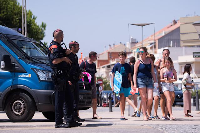 <p>Police officers patrol on the spot where five terrorists were shot by police on August 18, 2017 in Cambrils, Spain. (Photo: Alex Caparros/Getty Images) </p>