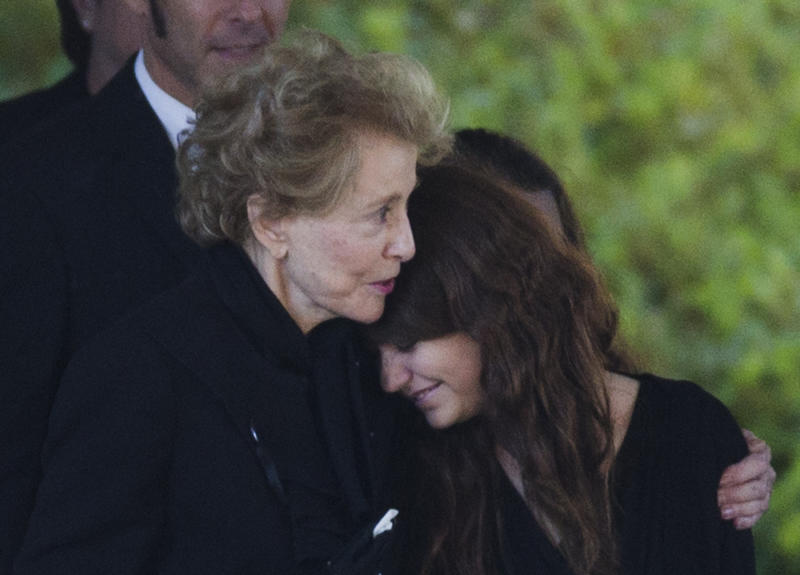 Joan Specter, left, hugs a woman as she and others leave Har Zion Temple after her husband, former U.S. Sen. Arlen Specter's funeral, Tuesday, Oct. 16, 2012, in Penn Valley, Pa. Family members say Specter died Sunday of complications from non-Hodgkin lymphoma. He was 82. (AP Photo/Matt Rourke)