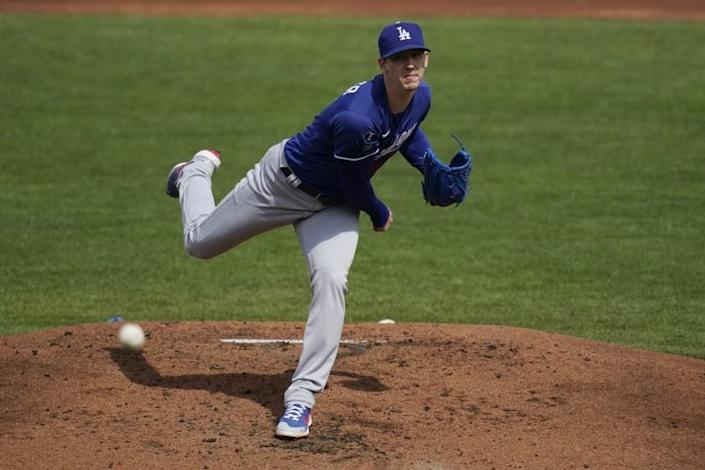 Los Angeles Dodgers starting pitcher Walker Buehler throws against the Cleveland Indians.