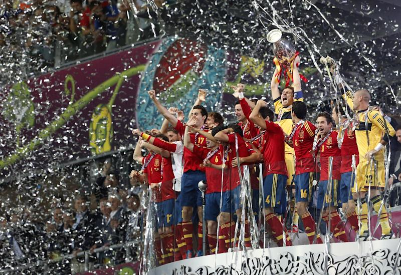 Spanish players celebrate with the trophy after the Euro 2012 soccer championship final between Spain and Italy in Kiev, Ukraine, Sunday, July 1, 2012. (AP Photo/Gregorio Borgia)