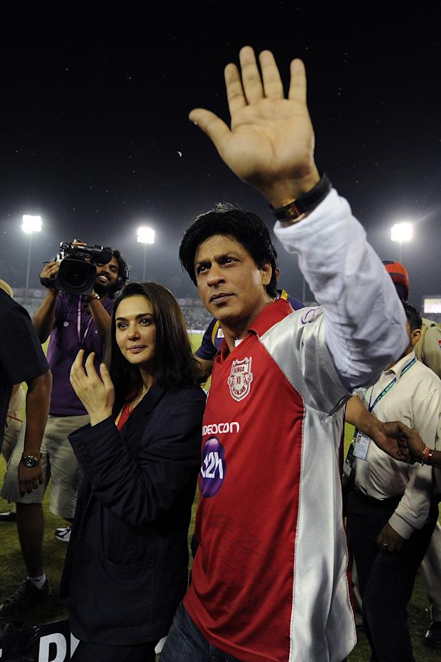 Bollywood actress and co-owner of the Kings XI Punjab cricket team Preity Zinta (L) walks alongside Kolkata Knight Riders co-owner and Bollywood actor Shahrukh Khan after the IPL Twenty20 cricket match between Kings XI Punjab and Kolkata Knight Riders at the PCA Stadium in Mohali on April 18, 2012.  AFP PHOTO/ Prakash SINGH RESTRICTED TO EDITORIAL USE. MOBILE USE WITHIN NEWS PACKAGE (Photo credit should read PRAKASH SINGH/AFP/Getty Images)