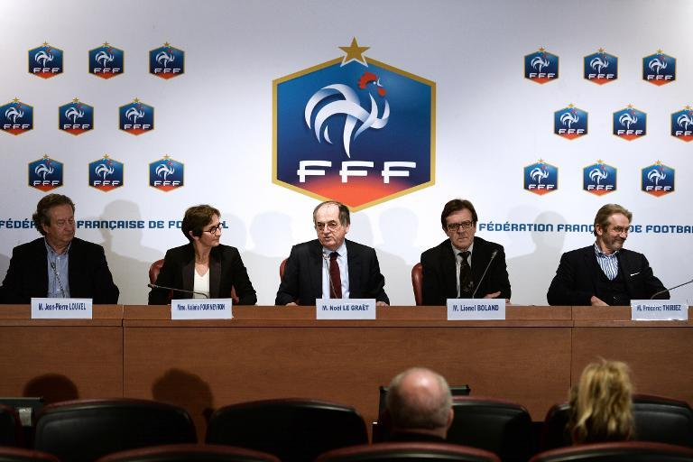 (L-R) French professional clubs union president Jean-Pierre Louvel, Sports Minister Valerie Fourneyron and Football Federation (FFF) president Noel Le Graet at a press conference at the FFF headquarters in Paris on March 21, 2013