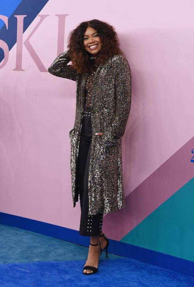 <p>Loving that awesome hair, and the super-glam get-up. (Photo: Getty Images) </p>