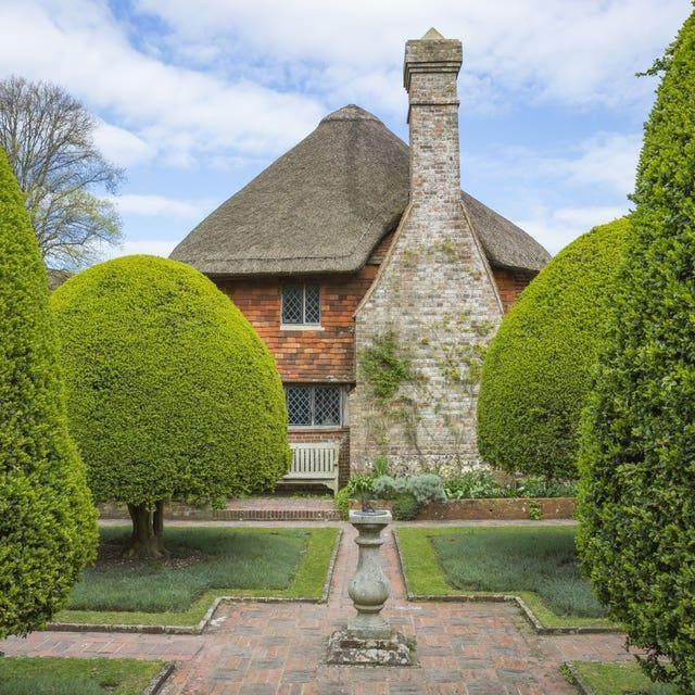 The sundial surrounded by topiary yew hedges at Alfriston Clergy House